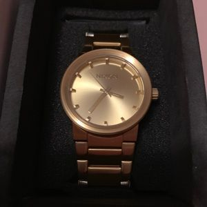 Nixon all gold colored watch